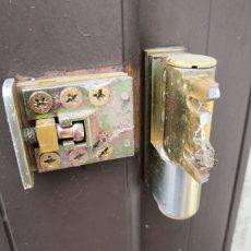 Broken UPVC French door hinges before removal